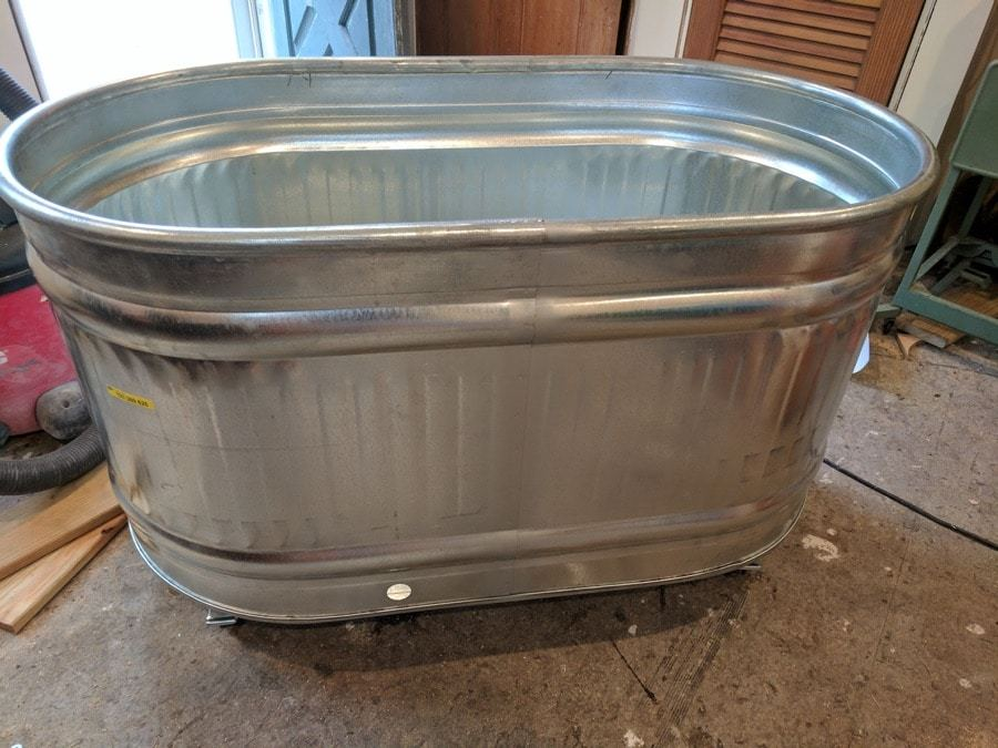 head outside to fill galvanized trough planters